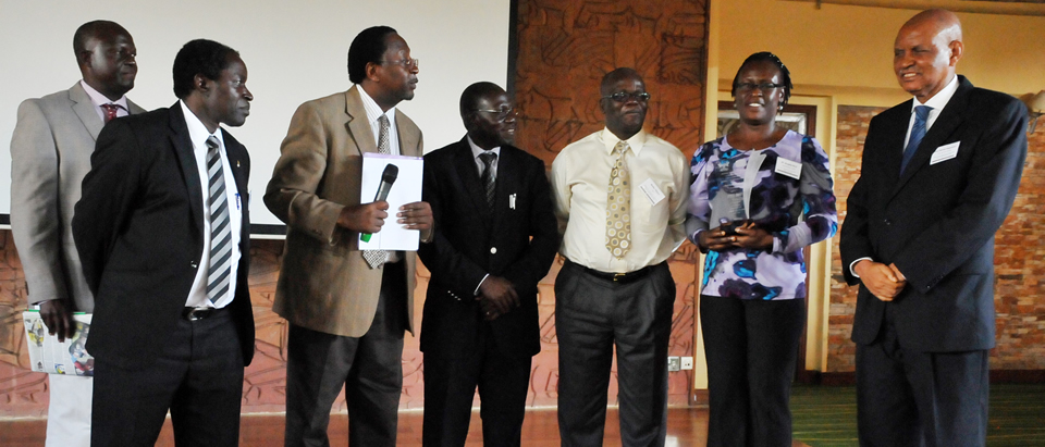 Dr Angella Akol after receiving the award for the best host institution 2013 - FHI 360